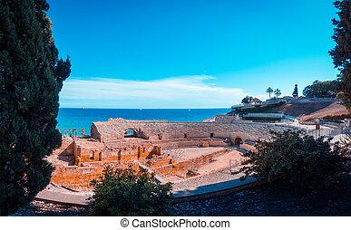 Roman amphitheatre in Tarragona, Costa Dorada, Catalonia, Spain, teal and orange view.