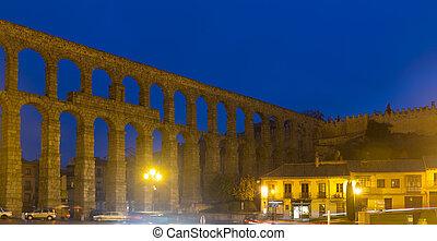 Roman aqueduct in night. Segovia