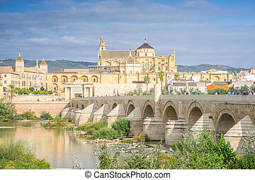 Roman bridge and cathedral - mosque by the river in Cordoba, Andalusia, Spain