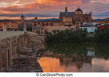 Roman bridge and La Mezquita at sunset in Cordoba