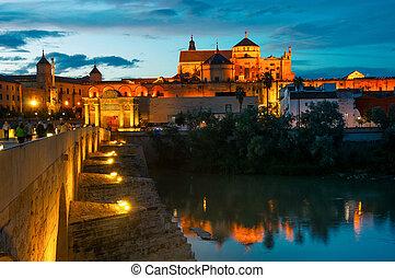 Roman bridge and La Mezquita at sunset in Cordoba, Spain