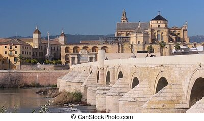Roman bridge over Guadalquivir river, Great Mosque-Cathedral and city view of Cordoba, Andalusia, Spain