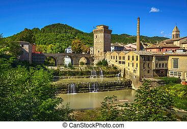 Roman bridge, medieval tower and Metauro river. Fermignano, Marche, Italy.