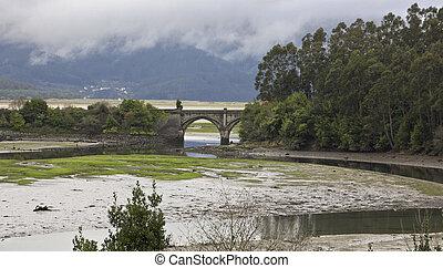 Roman bridge over a river in Galicia, Spain