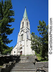 Facade of roman catholic church of Saint-Imier by sunny day, Jura, Switzerland. It was built in 1866.