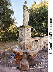 ancient statue in the park of the Villa Borghese