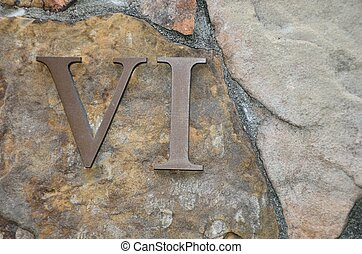 Roman numeral VI - six on rock wall - A metal Roman numeral ...