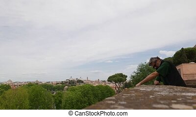 Roman overview - Tourist watching the view at top of...