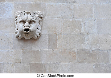Roman sculpture on the brick wall