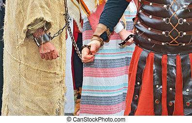 handcuffed prisoner - roman soldier and handcuffed prisoner