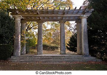Roman style pagoda with pillars and trellis work roof -...