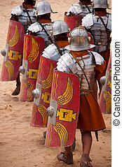 roman warriors in a battle formation walking to a fight