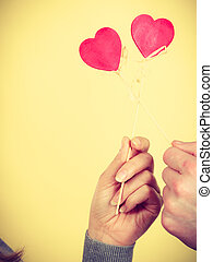 Two hands with love symbols.