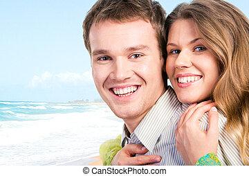 Romance - Close-up of beautiful joyful couple looking at ...