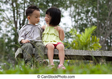 Romance dating - Two little kids dating with hand lifts onto...