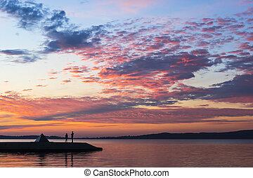 Romance on lakeside at sunset