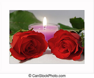 Red roses with pink candle