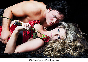 Romance - Romantic couple in lingerie with red rose on black...
