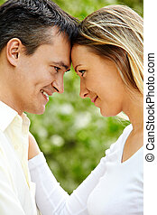 Romance - Portrait of young couple looking at each other...