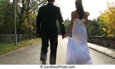 Romance - Young couple walking in the park.