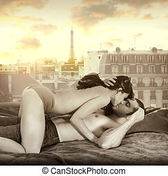 Romance - Young sexy couple making passionate love in bed...