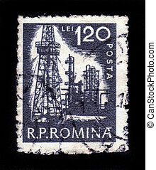 ROMANIA - CIRCA 1950: A stamp printed in Romania shows oil tower and refinery plant, circa 1950