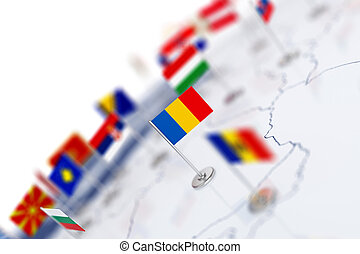 Romania flag in the focus. Europe map with countries flags