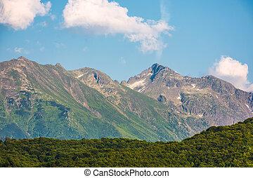 romania mountain ridge at sunrise. blue sky with clouds