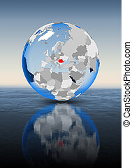 Romania on globe in water