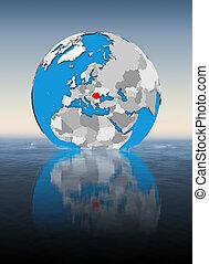 Romania on globe in water