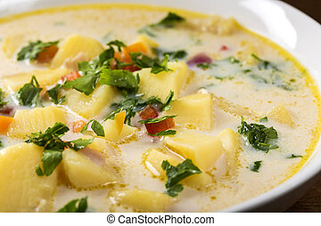 Romanian Homemade potato soup with sour cream and vegetables