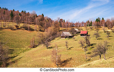 Romanian old sheepfold on the hill in the fall season