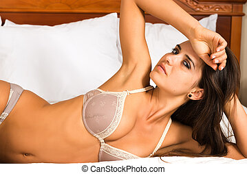 Romanian - Pretty young Romanian woman in mauve lingerie