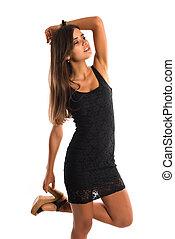Romanian - Beautiful slender Romanian woman in a short black...