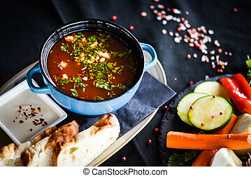 romanian traditional turkey soup with fresh vegetables, wipe cream, spices & home made bread