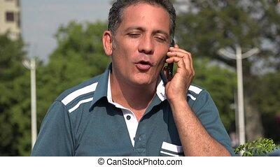 Romantic Adult Hispanic Man Talking On Cell Phone