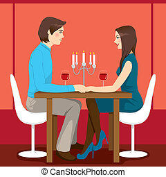 Romantic Anniversary Dinner - Young adult couple drinking...