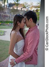 Romantic Asian couple embracing