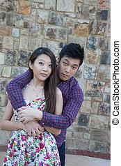 Romantic Asian couple outdoors
