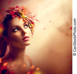 Romantic autumn girl with colorful yellow and red leaves on...
