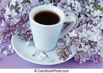 Romantic background with cup of tea, lilac flowers