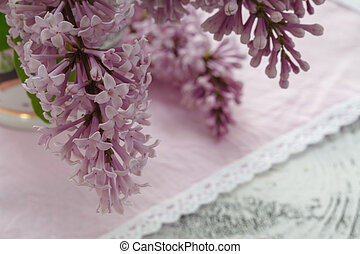Romantic background with cup of tea ,lilac flowers