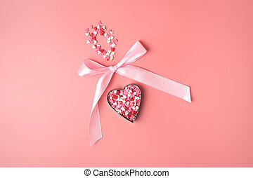 Romantic background with heart bow on pink background.