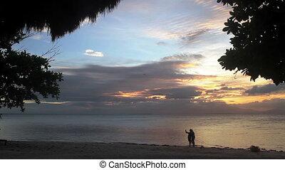 Romantic Beach Selfies - An LGBT couple strolls along a...