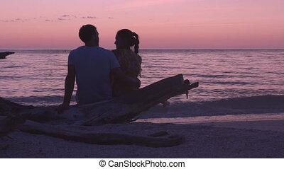 Romantic beach sunset couple honeymoon - Lovers enjoying ...