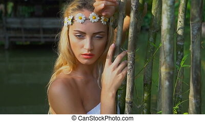 Romantic beauty in the garden - Closeup face of stunning...