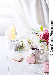 romantic breakfast in bed. Coffee , cookies ,gift box and flower on wooden table. Valentine's day concept