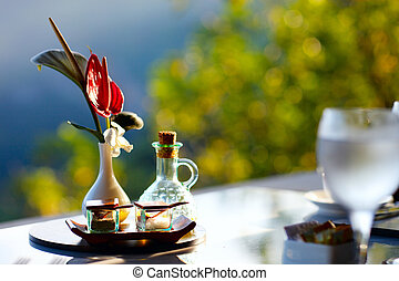 Table set for romantic breakfast outdoors