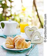 Romantic breakfast with love. Croissants, coffee, juice,...