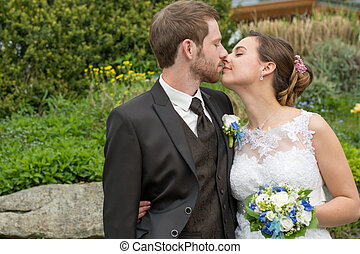 romantic bridal couple kissing